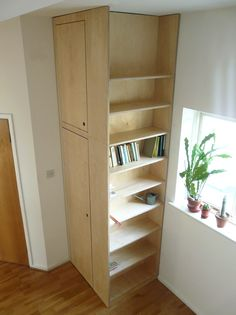 utility cupboard with shelving constructed in birch plywood.jpg