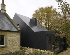 Shadow House by Jonathan Tuckey Design A black timber extension to a historic stone chapel in England appears as a three-dimensional shadow of the old building. Facade Architecture, Residential Architecture, Contemporary Architecture, Minimal Architecture, Black Building, Building A House, Extension Veranda, Renzo Piano, Timber House