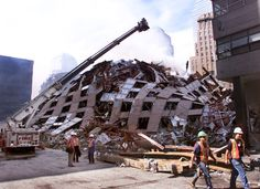 9-11 Photos--Attack on the World Trade Center. Seven hours after the World Trade Center twin towers fell, the 47-story WTC building 7 collapsed.
