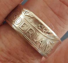 Ring uit een zilveren rijksdaalder  met een smalle band
