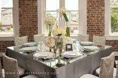 Platinum lamour with square mirror top, calla lilies, mixed metal sequin chiavari chair caps at Station 3 wedding venue