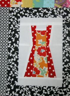 Apron quilt block!  This would look cute as a border on tea towels... perhaps?