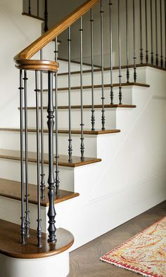 An historic residence constructed in the was completely renovated by Jessica Helgerson Interior Design, located in Portland, Oregon. Stair Handrail, Staircase Decor, Iron Stair Railing, Staircase Railings, Staircase Design, Wrought Iron Stairs, House Stairs, Home Stairs Design, Stair Railing Design