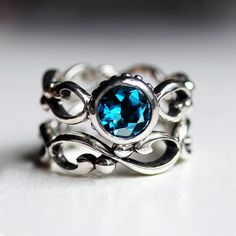 Blue topaz engagement ring set - bezel solitaire - recycled sterling silver - filigree wedding band- London Blue - teal blue -Wrought ring. $308.00, via Etsy.