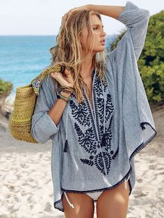 Looking to master that island vibe? Meet your cover-up. The pretty embroidery, tassels and mini pompom trim make this tunic perfect for taking in sunsets in Tulum…or even taking in the tunes at Coachella. | Victoria's Secret Tie-front Tunic