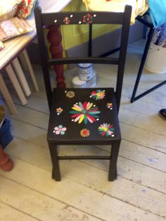 Beautiful chair painted in graphite and dark wax.chalk paint annie sloan. Stencilled some lovely flowers. Love it.