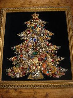 Christmas tree made from old jewelry. I saw these being made years ago but they drilled holed in the base board before gluing on the jewelry and then poke a string of white Christmas lights through the holes.  Gorgeous when lit up!