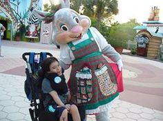 Ms. Merry posing with a precious wish child during Winter Wonderland at #GKTW