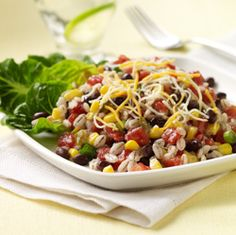 Barley, corn, black beans and zesty tomatoes tossed together for a colorful, flavor-packed salad