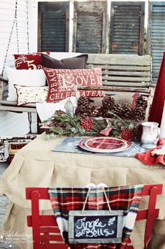 Beautiful rustic and traditional Christmas decor for the front porch. Red and green tartan plaid, chalkboard, and swing.