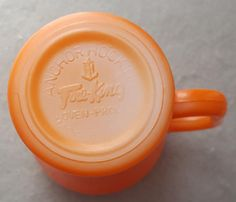 Fire King mug; Anchor Hocking soda fountain cola mug in mint condition made in the USA. Fired on orange outside is perfect. Inside is glossy white.