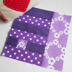 100 Modern Quilt Blocks - Block 57 - Daisy Chain. Am beginning to love purple fabric - especially when it has daisies on.