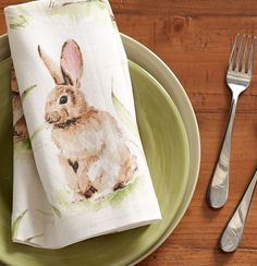 A pastoral scene in soft hues makes these napkins a natural addition to Easter dining. We even have a table runner to match!