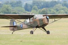 Auster Mk.3 G-AREI / MT438 taxiing at Middle Wallop airfield.