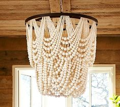 Amelia Indoor/Outdoor Wood Bead Chandelier #potterybarn Not usually a fan of wood bead lighting but this looks like strands of pearls! love it.