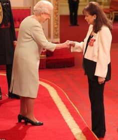 Writer Jackie Collins receives her OBE insignia from The Queen during an Investiture at Buckingham Palace, 28 November Jackie Collins, Joan Collins, Short Conversation, Royal Diary, House Of Windsor, Royal Engagement, British Monarchy, Buckingham Palace, British Royals