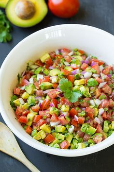 Avocado Salsa | Cooking Classy-6 medium roma tomatoes (20 oz), seeded and diced 1 cup chopped red onion, chopped 1 large or 2 small jalapeños, seeded and chopped (1/4 cup. Leave seeds if you like heat) 3 medium avocados, semi-firm but ripe, peeled, cored and diced 3 1/2 Tbsp olive oil 3 Tbsp fresh lime juice 1 clove garlic, finely minced 1/2 tsp salt (more or less to taste as desired) 1/4 tsp freshly ground black pepper 1/2 cup loosely packed cilantro leaves, chopped
