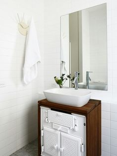 Remodelled stove into a sleek bathroom cabinet