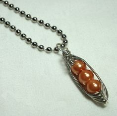 Pendant, Three Peas In A Pod, Light Orange Pearl, Silver Wire, Unique Jewelry by thecuriouscupcake on Etsy. $10.00, via Etsy. They will make them with up to 6 beads in them - great grandchildren necklace, I think!!!