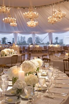 The chandeliers, the centerpieces, the tent... Perfect.