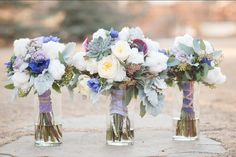 Beautiful blue and ivory bouquets for a country wedding