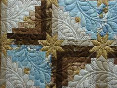 Quilt Vine: Log Cabin Stars - Note the feather quilting - wonder how long it took to make this one.