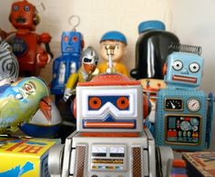 Robot Toys. There are lots of different styles, some old, some new, some replicas. They can really range in price. I think my husband would be fine with a replica.