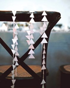 Add a special sign or décor to the back of your maid of honor's chair so everyone knows who she is. She can even take it home as a memento from the special day.