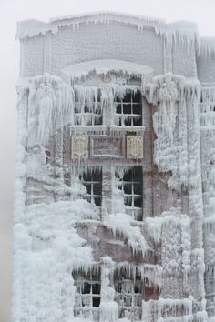 Fire and Ice: The Frozen Aftermath of a Chicago Warehouse Fire - Temperatures were so low during the fire that water sprayed on the building froze almost instantly leaving behind a spectacularly beautiful ice-encrusted wonderland.
