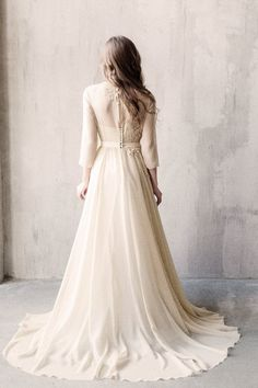 Olive long sleeves vintage wedding dress with a corset / http://www.deerpearlflowers.com/unique-sophisticated-wedding-dresses-from-cathy-telle/