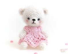 Amigurumi miniature teddy bear toy, crochet stuffed plush bear animal with clothes   Miniature 5-way jointed 3,5 inches (9cm) teddy bear.  It has been crocheted from a blend of alpaca, polyamide and merino yarn, it has black bead eyes, its facial features have been stitched with a black cotton thread and lightly shaded. It wears a pink knitted dress. Bear Animal, Teddy Bear Toys, Crochet Teddy, Newborn Photo Props, Plush Animals, Cotton Thread, Wool Yarn, Black Cotton, Facial