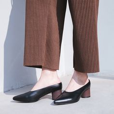 Chiko Viliam Glove Shoe Pumps Mules feature pointy toe, easy slip on and off, block heels with rubber sole.