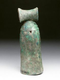 Vietnamese Dong Son bronze bell,  Southeast Asia, Vietnam, 2500 B.C. Fine bronze bell of elongated form, tapered crown with incised coils, upper shoulder with repeating incised rings, clapper rusted to side of interior, 15.2 cm high. Private collection