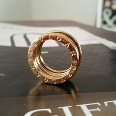 Ring Beautifull stainless steel ring Gold-plated. Bulgari is not authentic but, looks great.  Bulgari Jewelry Rings