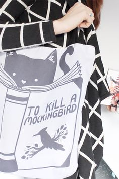 """Very important reading list for your resident feline... just watch out for the book report. """"To Kill a Mockingbird"""" print by Tobias Fonseca on Redbubble—hilarious!"""