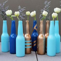 Turn empty beer bottles into pretty bud vases with this basic DIY... If I would have only known about this when I lived in Santa Barbara...