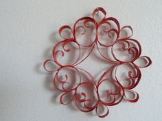 circular burnt orange ornament made of toilet paper rolls! $11.00, via  muhwalkee on Etsy.