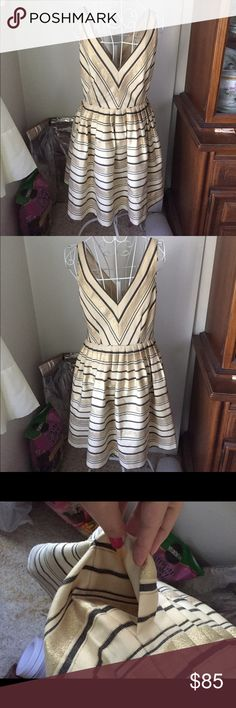 Double v dress Has pockets! Heavy cotton polyester blend with shimmery gold stripes. condition as shown and reflected in price. This item is in good condition but it has been worn please ask any questions before purchasing. This item will only be traded for an autographed Authentic Chanel original, a Lamborghini, a penthouse in Paris, or the services of an Audi mechanic. All orders will be recorded before shipping. I do not model. Please see my reasonable offer chart before submitting an…