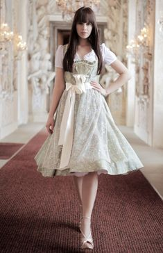 Dirndl dress with a wisp of fluff petticoat while walking. Long dark brown hair with bangs  All lovely, photo by von Trachteria.