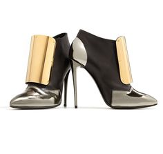 ROCK CHICK CHIC: Once a DJ, it's no surprise that Giuseppe Zanotti's latest metallic booties are reminiscent of Daft Punk.