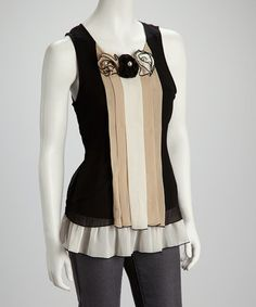 Take a look at this Black & White Rosette Pleated Sleeveless Top by Madison Paige on #zulily today!