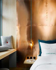 Bright idea. When you're feeling down, try adding a metallic accent wall into your home. Because a shiny wall can brighten even the dullest of days, right? | photo: Stephan Lucius Lemke