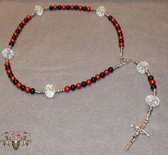 Black, Red and Clear Crystal Bead Rosary Visit www.twistedthingamajigs.com to see place your order and see more of our merchandise.
