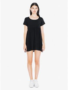 c2171601079e A short sleeve babydoll dress featuring a loose waistline and an open  neckline. American Apparel