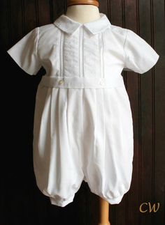 This is a traditional little boys baptism or christening outfit with gorgeous style. The little collar has stitched detailing which is repeated on the front along with ladder-stitching for a delicate look. Short sleeves and pleats at the waist make this a roomy, comfortable outfit for your baby boy.