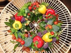 Designed by Your London Florist. I got an unusual funeral order. A daughter ordered a funeral wreath for her late father. He was a passionate gardener. So we made an arrangement using vegetables. It's good to be different!  http://yourlondonflorist.co.uk/