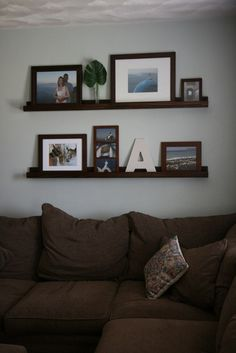 Gallery Wall & DIY Picture Ledges- a fyi for me regarding height of ledge above couch!