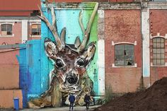 Earlier this month, Stavanger, Norway, hosted the 15th annual Nuart festival, a celebration of street art attended by international talents who demonstrate their craft throughout the streets, sidewalks, and walls of the town. Pictured here is a sculpture that Portuguese artist Bordalo II constructed on the wall of an abandoned building with a combination of garbage and paint.