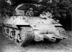Tank Destroyer equipped with the Rhinoceros hedgerow cutter, prior to Operation Cobra, in France, circa mid-July 1944