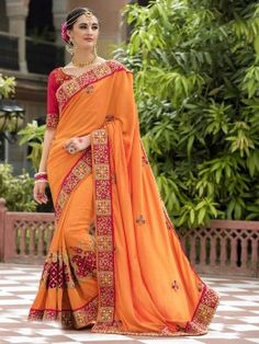 Distinguished orange and pink dupion silk festival wear silk saree. Having fabric silk and dupion. Beautified with embroidery work, cut work, stone work, border work, patch work and pearl embellished all synchronized effectively with all the pattern and design of the attire. Comes with matching blouse. (Slight variation in color, fabric and work is possible. Model images are on..